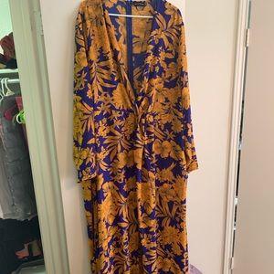 Orange and blue maxi dress with split.